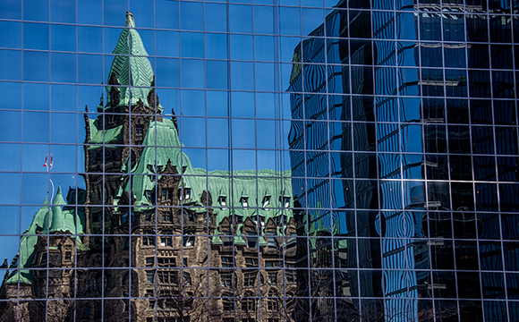 Parliament Hill reflected in downtown Ottawa office building