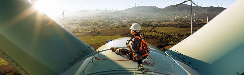 Technician sitting on wind turbine